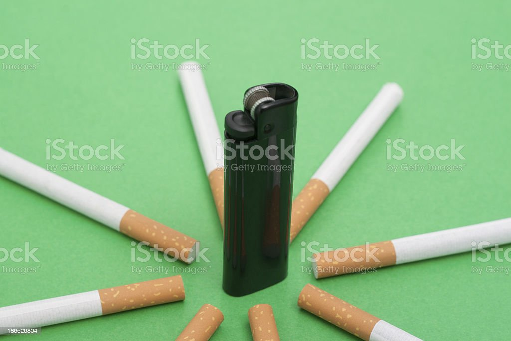 lighter in the middle, between cigarette royalty-free stock photo