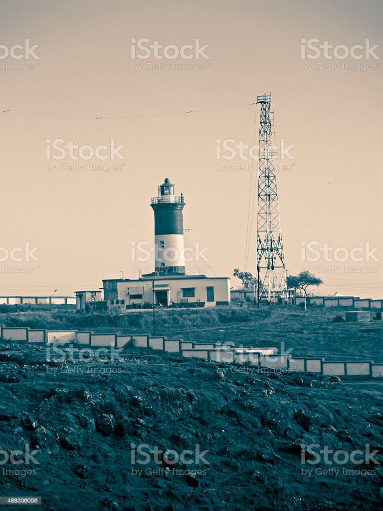 Lighthouse & A signal receiving tower of television stock photo