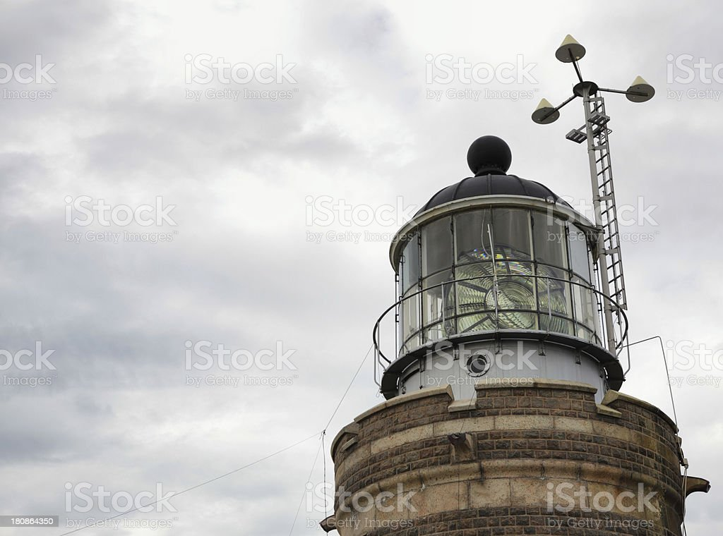 Lighthouse against moody sky royalty-free stock photo