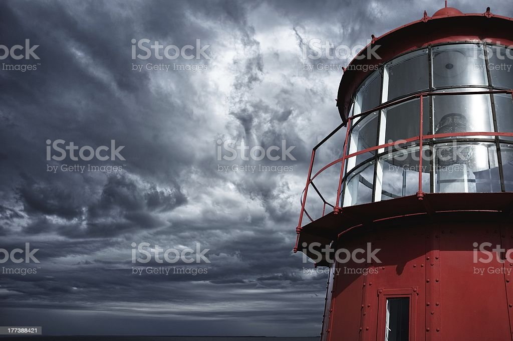 Lighthouse against  stormy sky stock photo