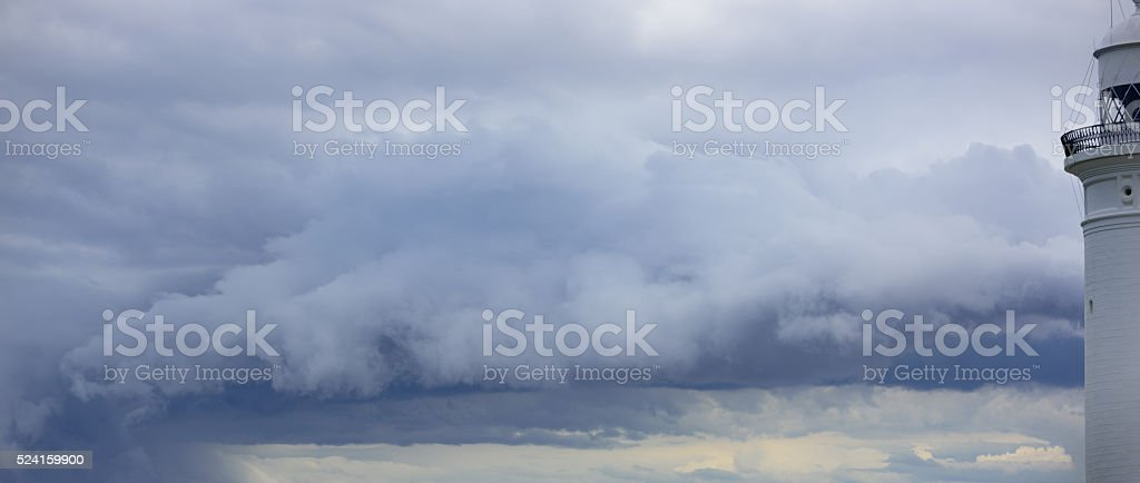 Lighthouse and bad weather in background stock photo