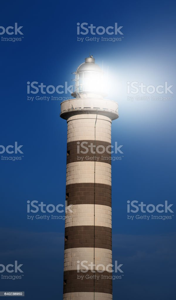 Lighthouse and beam stock photo