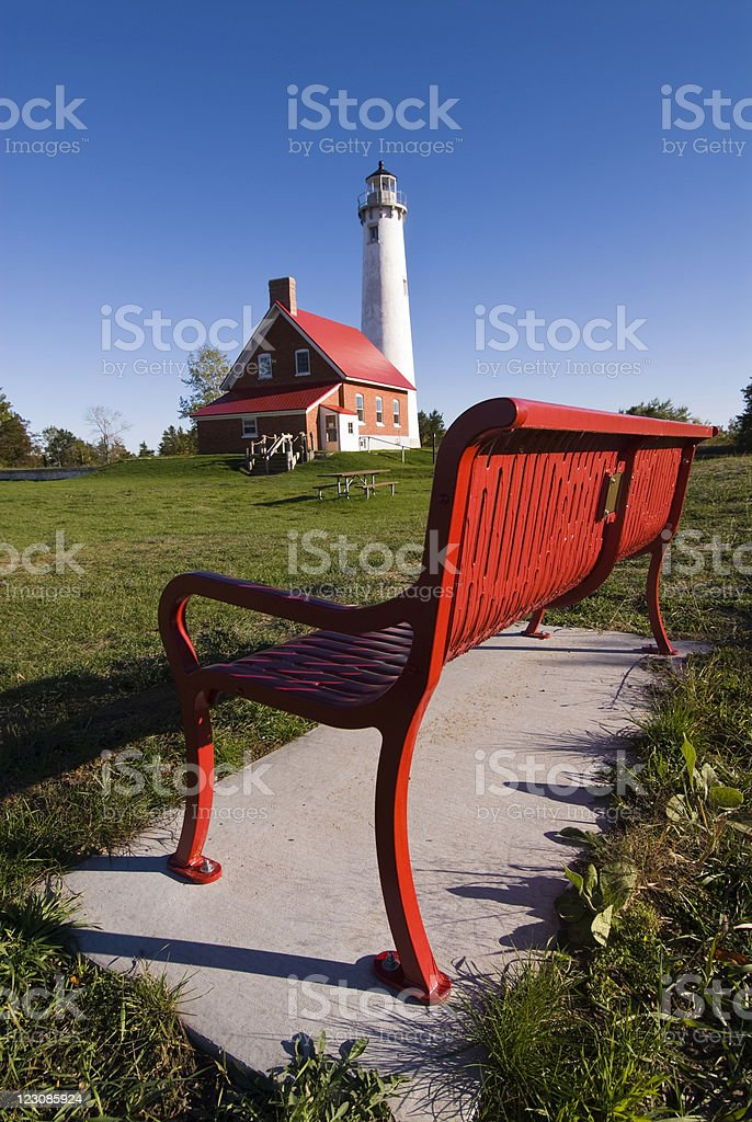 Lighthouse and Bench stock photo