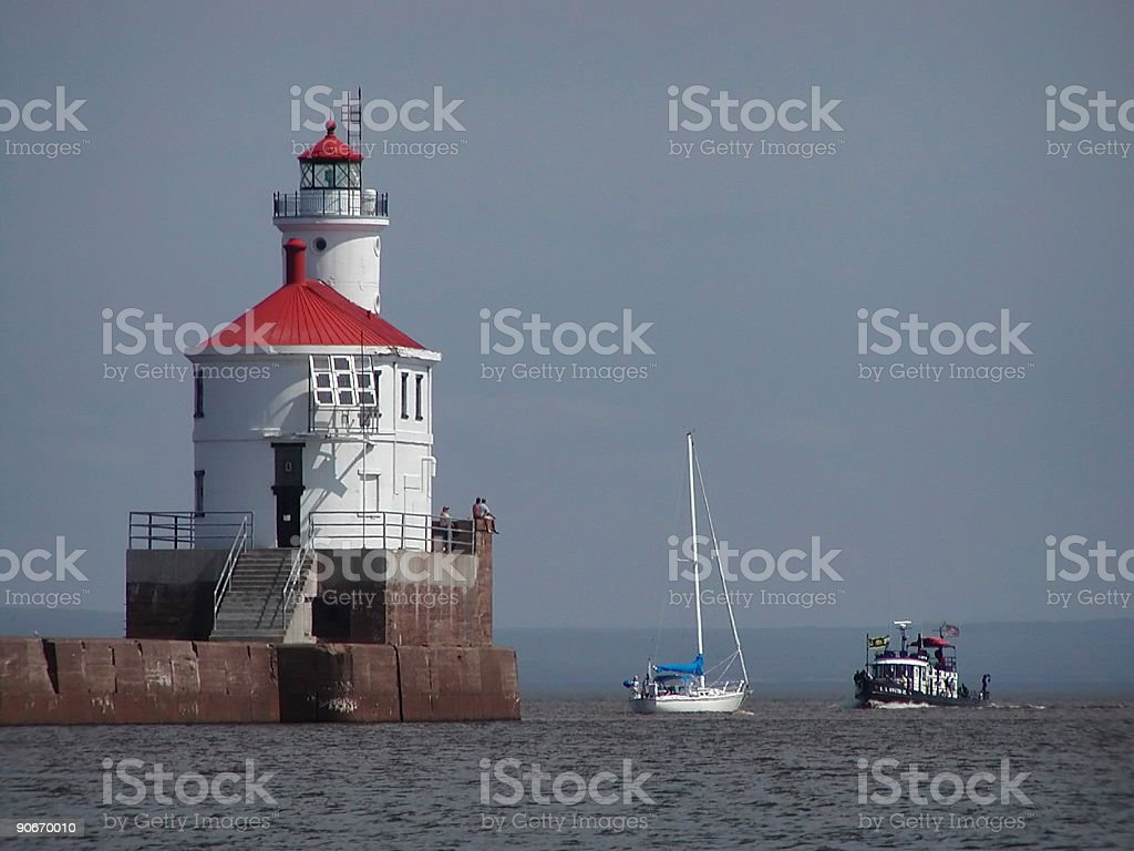 Lighthouse and Boats royalty-free stock photo