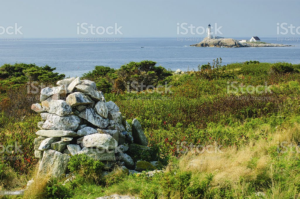 Lighthouse and Cairn stock photo