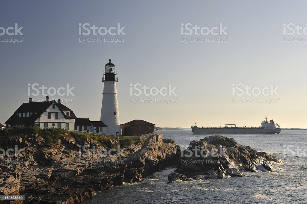 Lighthouse and Cargo Ship stock photo