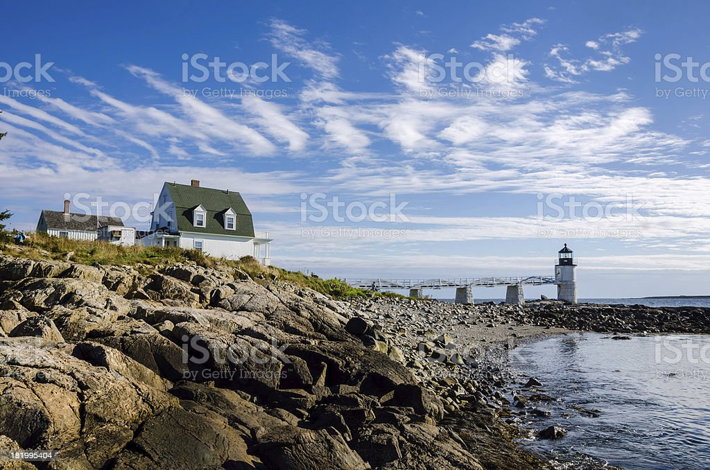 Lighthouse and Cloudy Sky stock photo