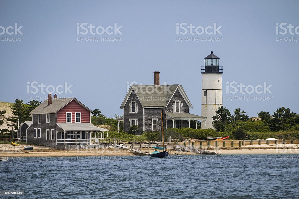 Lighthouse and Cottage stock photo