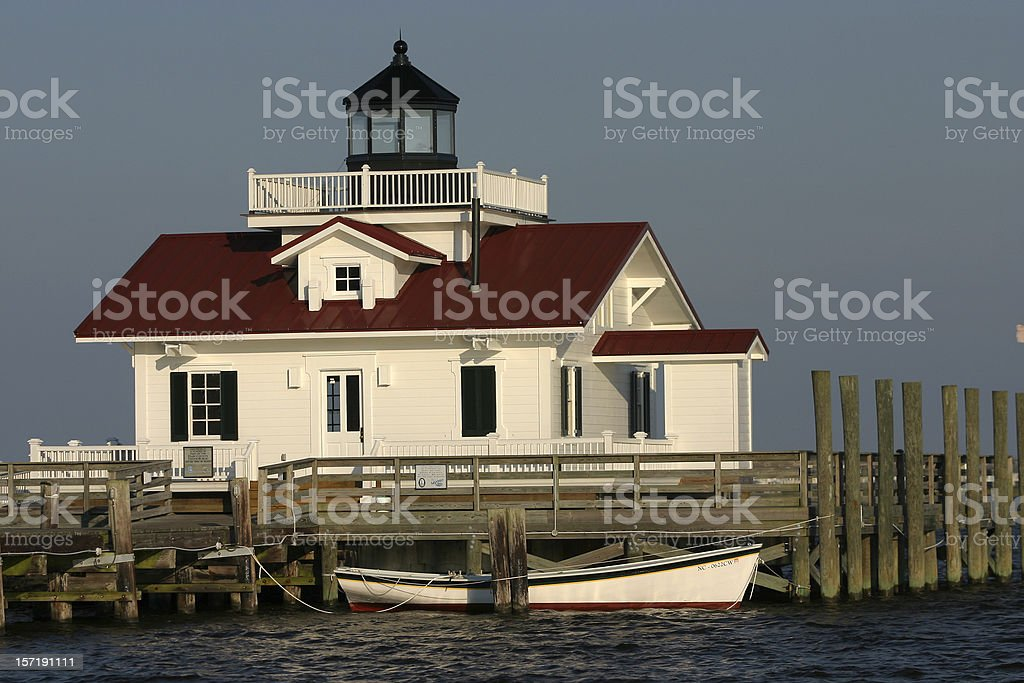 Lighthouse and Dory stock photo