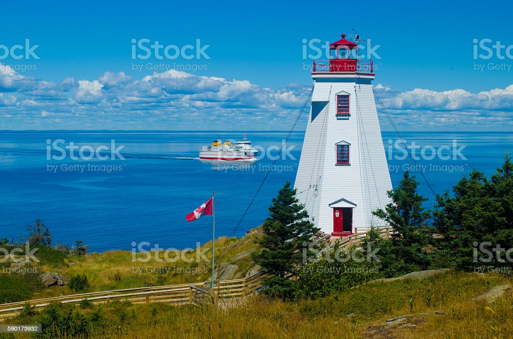 Lighthouse and ferry stock photo