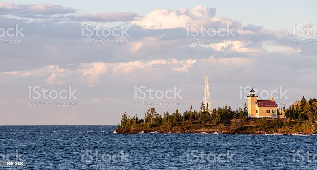 Lighthouse and Gathering Clouds in Evening Light stock photo