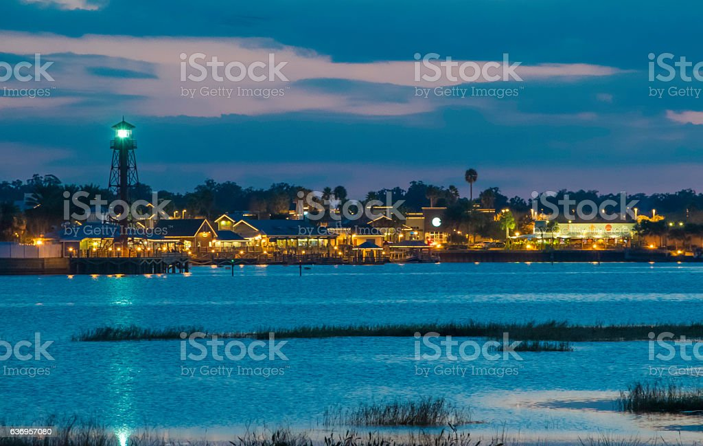 Lighthouse and Harbor in Evening stock photo
