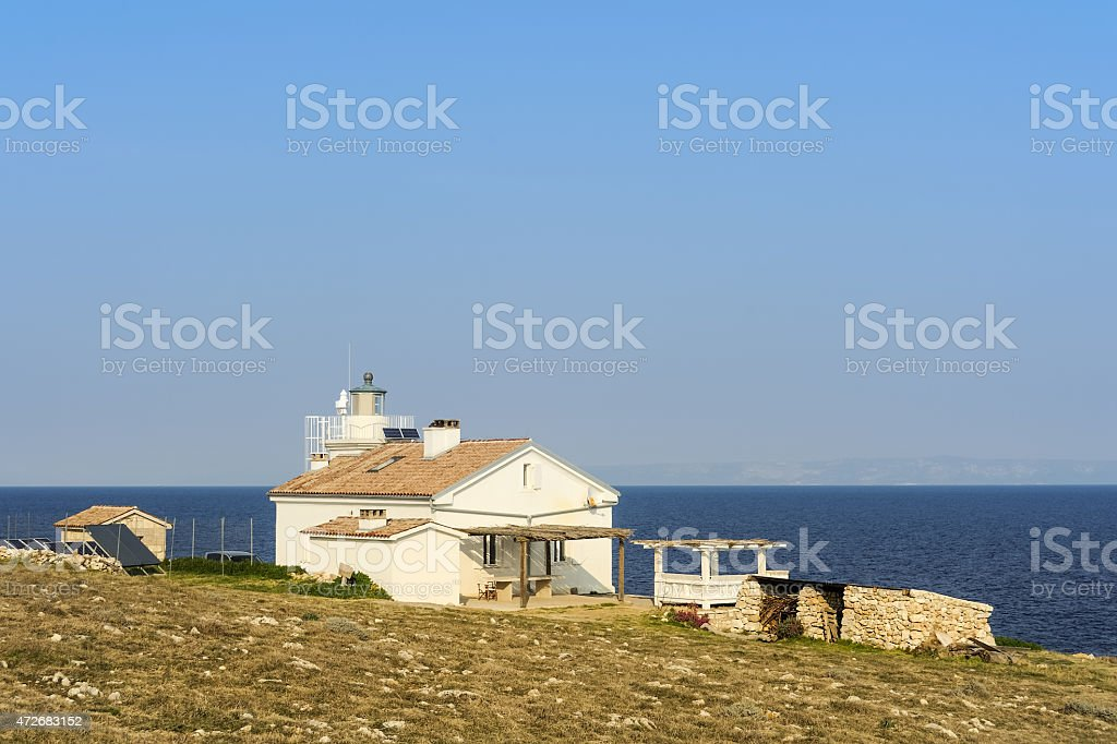 Lighthouse and house rental stock photo
