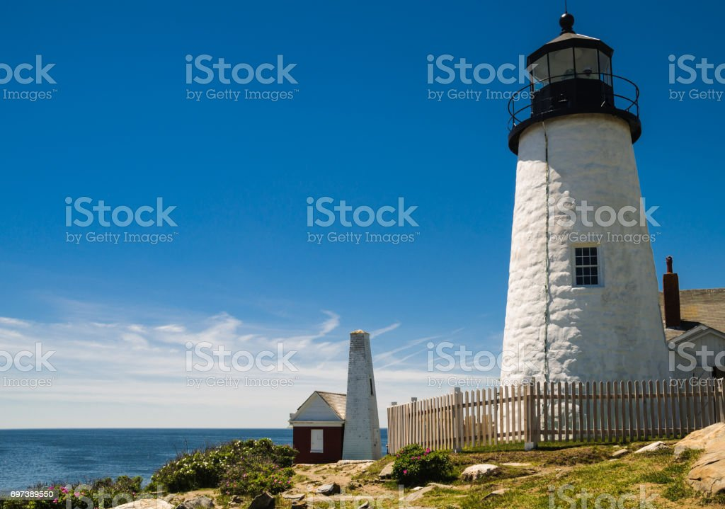 Lighthouse and Oil Shed stock photo