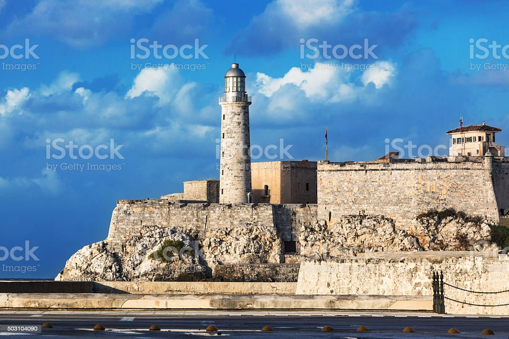 lighthouse and  old fortress stock photo