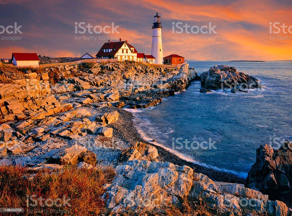 A lighthouse and shoreline on the coast of Maine, USA stock photo