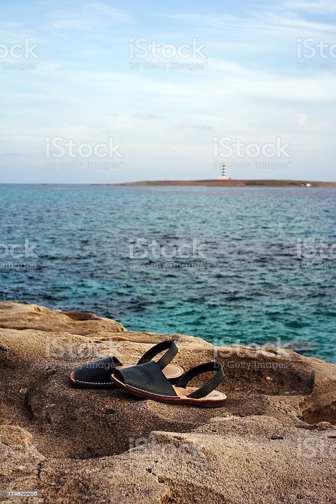 Lighthouse and summer shoes. stock photo