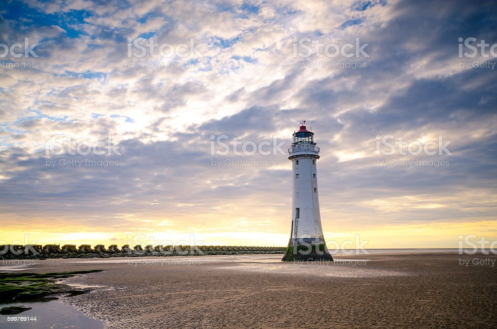 Lighthouse and the cloudscape stock photo