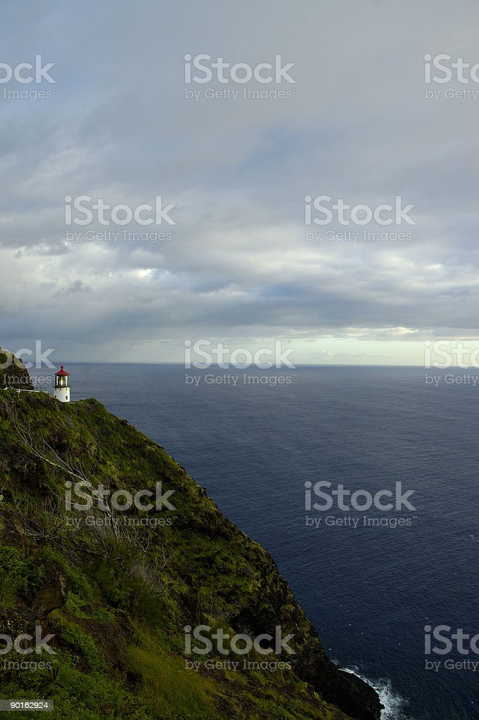 Lighthouse and the Pacific Ocean during a stormy sky stock photo
