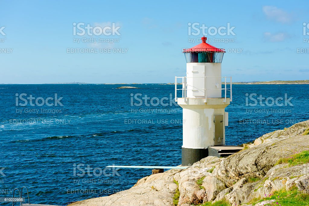Lighthouse and wakes stock photo