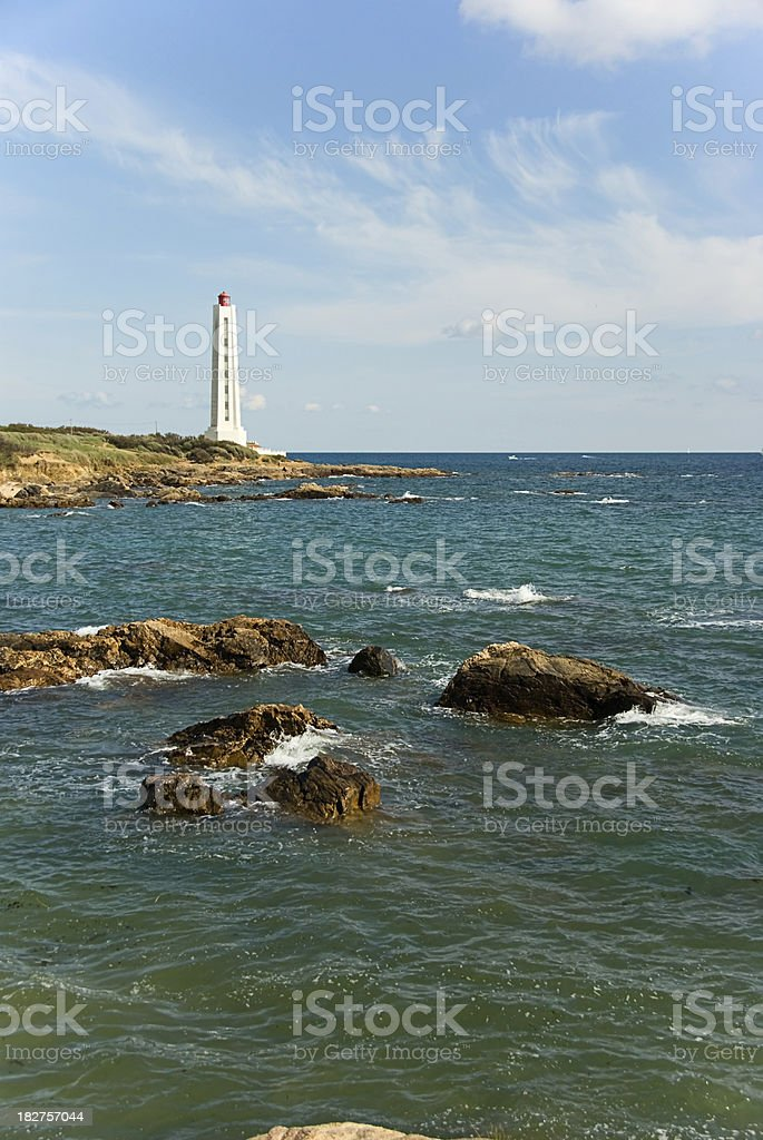 Lighthouse at Atlantic shore stock photo