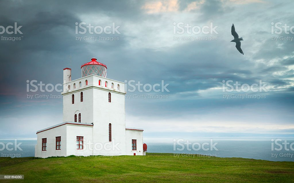 Lighthouse at Dyrhólaey peninsula in Iceland stock photo