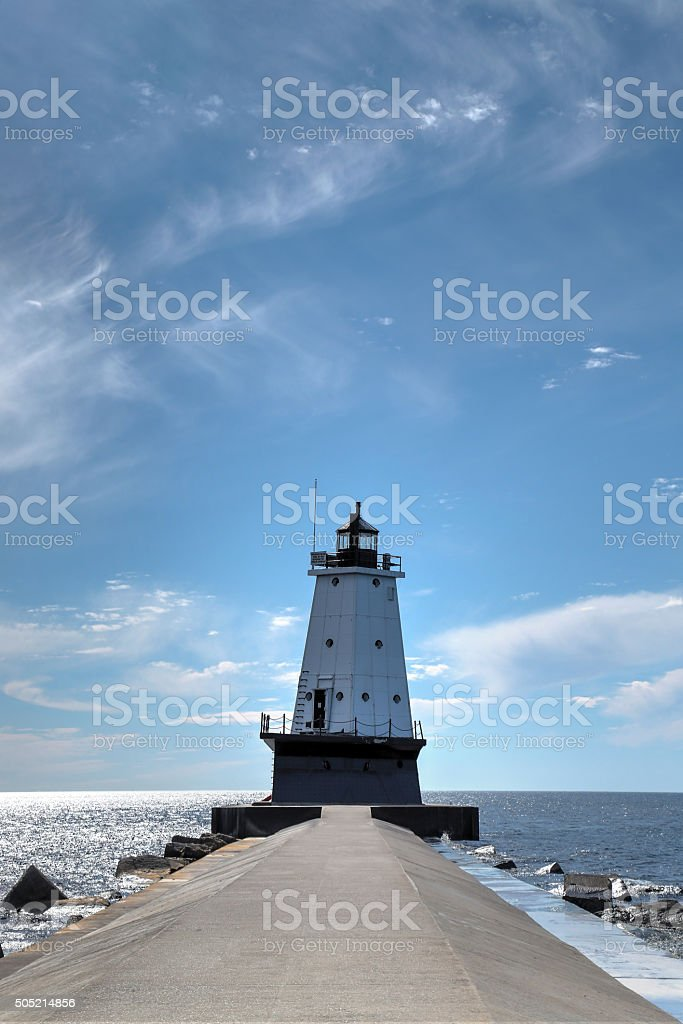 Lighthouse at end of a breakwater stock photo