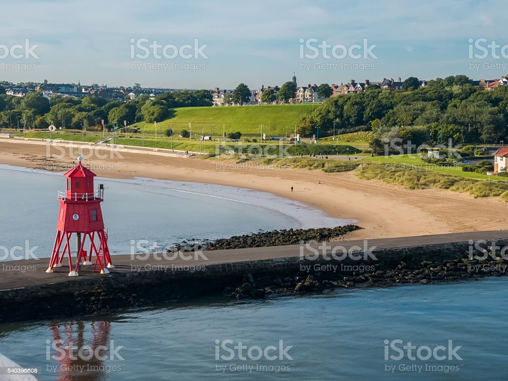 Lighthouse at harbor of Newcastle, England stock photo