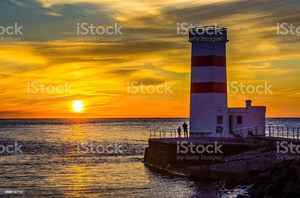 Lighthouse at Iceland coast stock photo