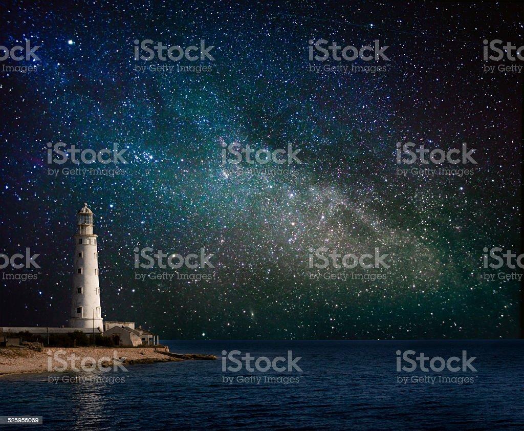 lighthouse at night stock photo
