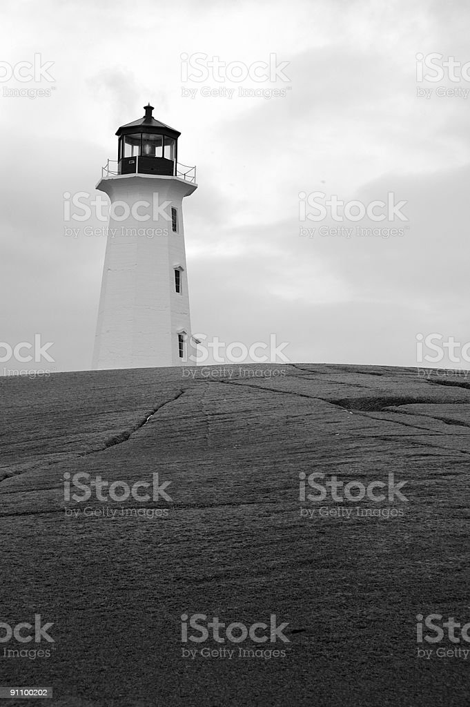 Lighthouse at Peggy's Cove on a cloudy day royalty-free stock photo