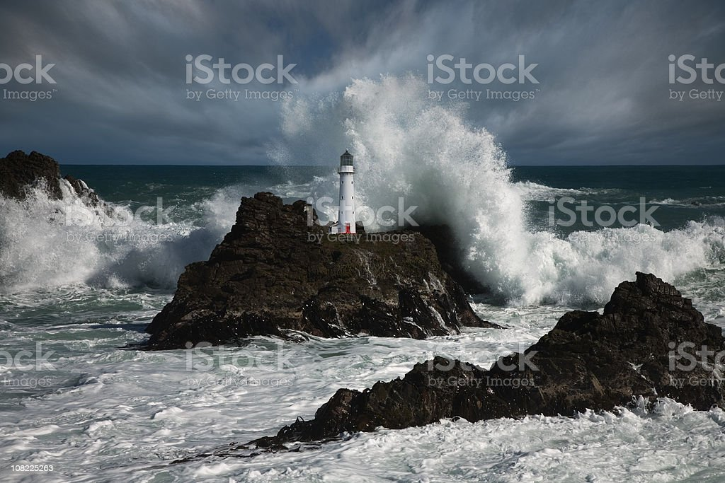Lighthouse at storm stock photo
