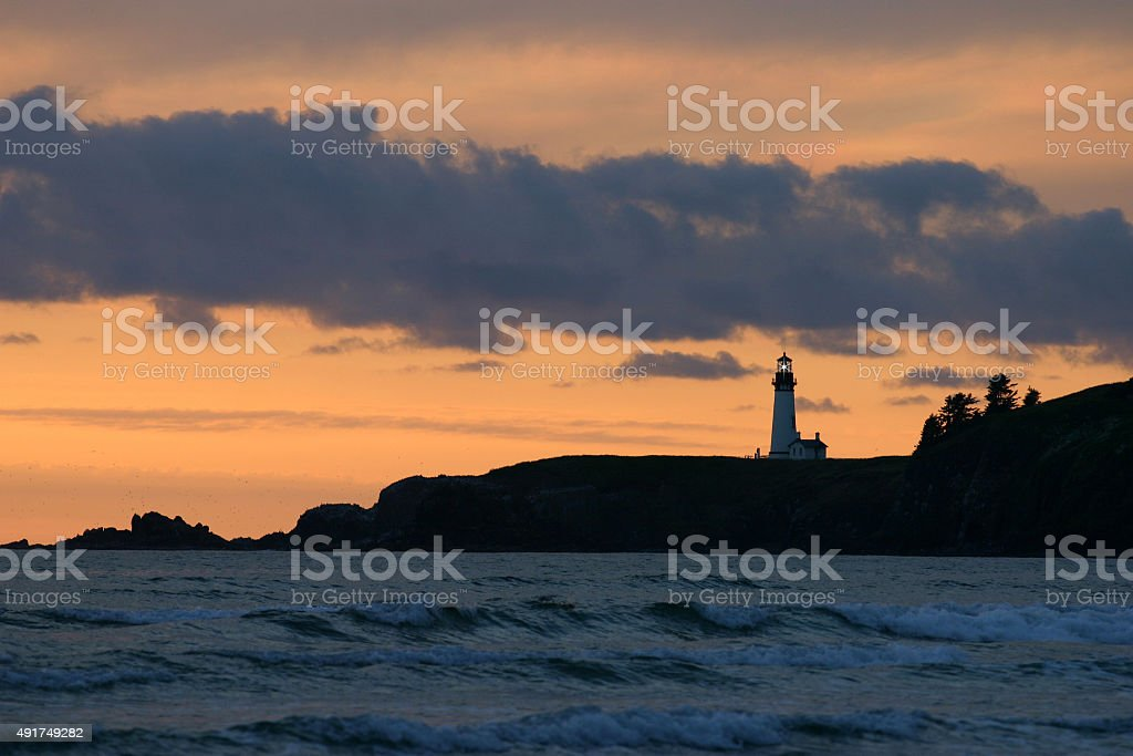 Lighthouse at Sunset on the Pacific Ocean stock photo