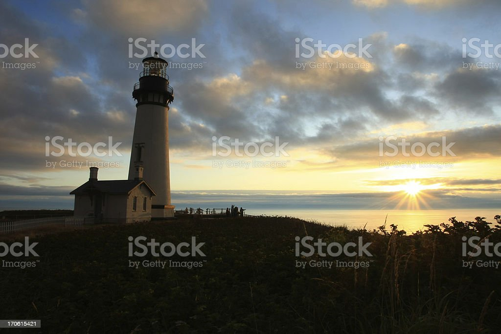 Lighthouse at Sunset stock photo