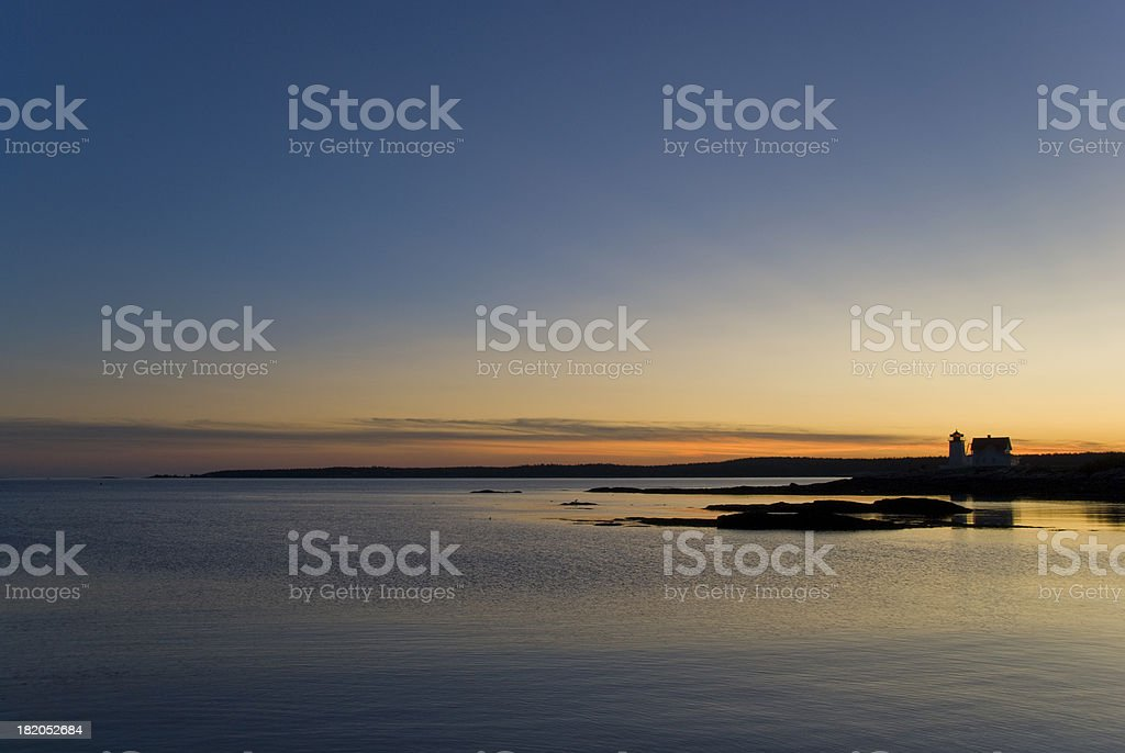 Lighthouse at Sunset stock photo