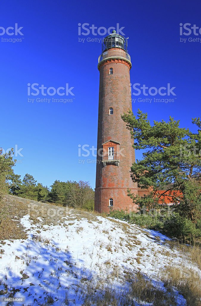 Lighthouse at the Baltic Sea in winter stock photo