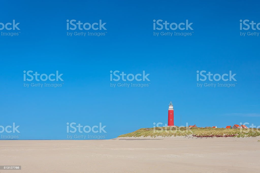 Lighthouse at the Dutch island of Texel stock photo