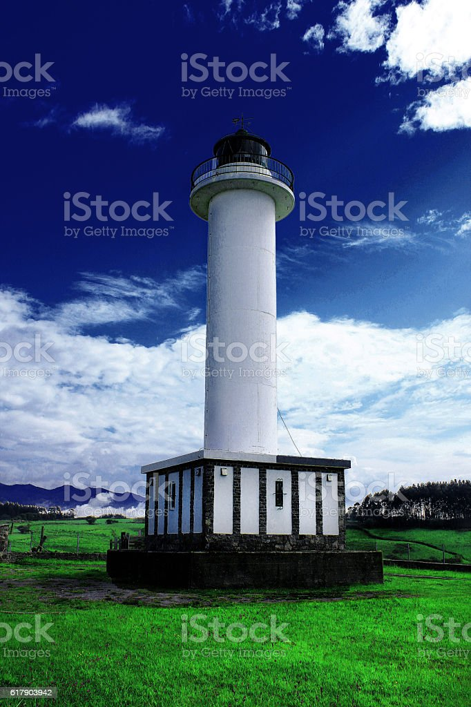 Lastres lighthouse stock photo