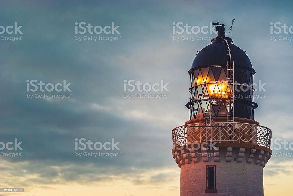 Lighthouse beacon at dusk stock photo