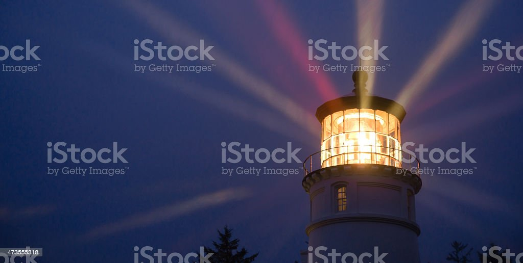 Lighthouse Beams Illumination Into Rain Storm Maritime Nautical stock photo