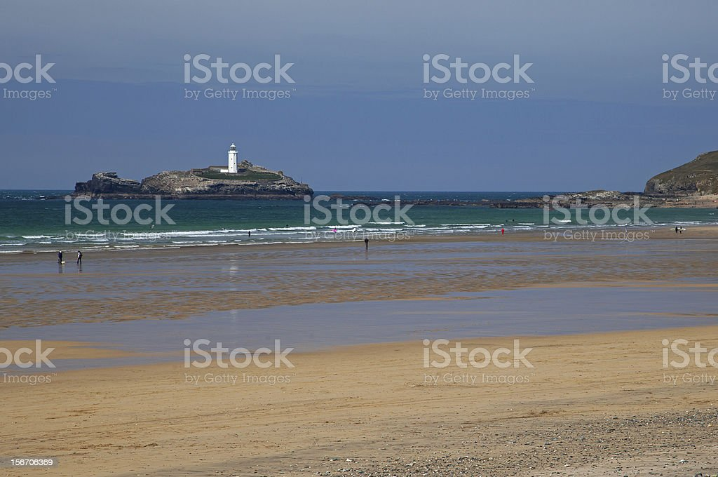 Lighthouse - Cornwall, Godrevy beach with bathers stock photo