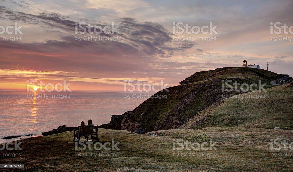 Lighthouse Couple Sunset stock photo