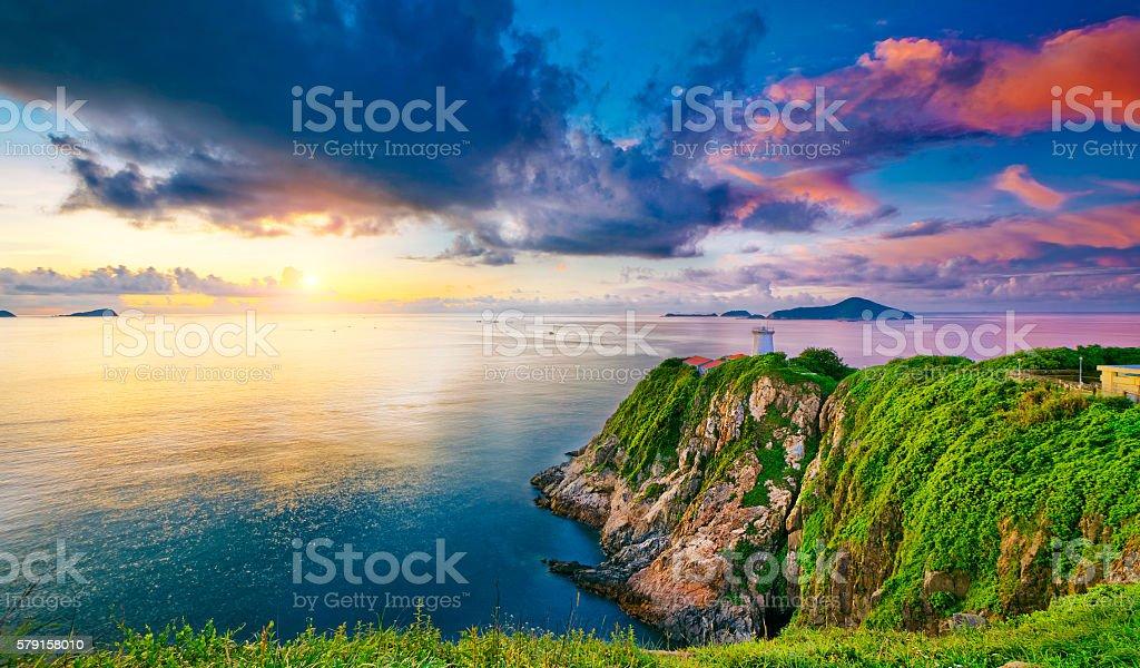 lighthouse during sunrise stock photo