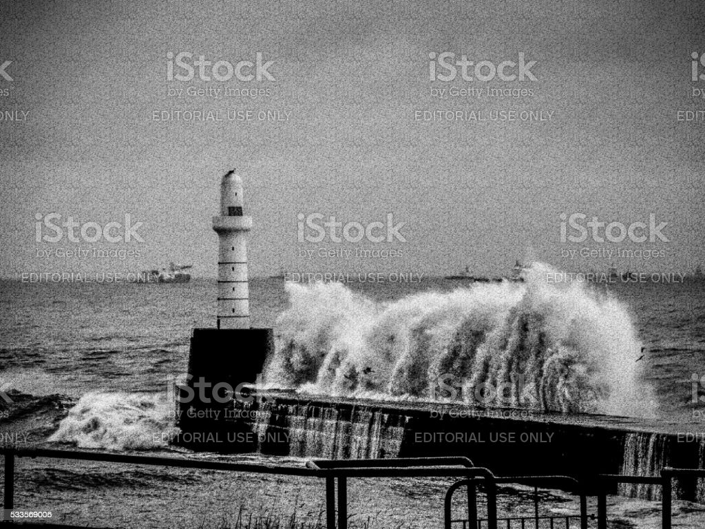 Lighthouse Engulfed in Storm Waves, Aberdeen, UK stock photo