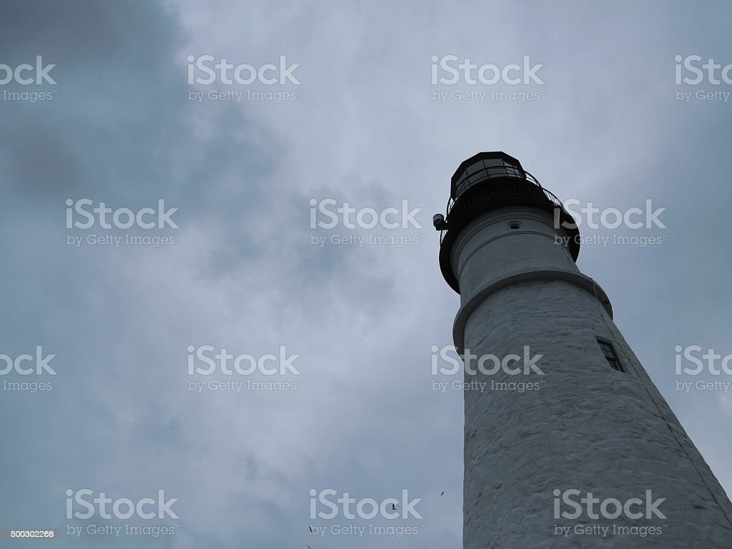 Lighthouse in Cape Elizabeth, Maine with sky. stock photo