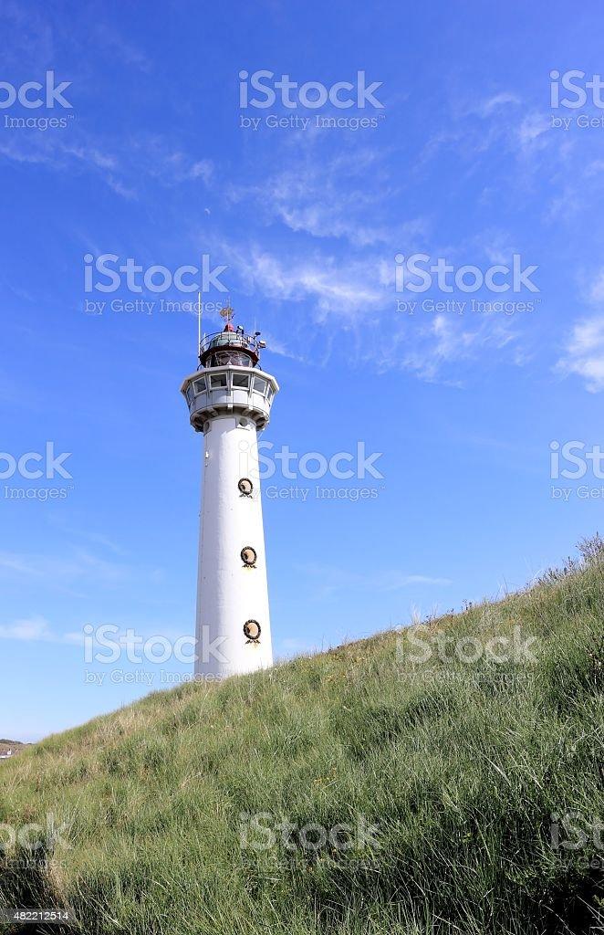 Lighthouse in Egmond aan Zee. North Sea, the Netherlands. stock photo