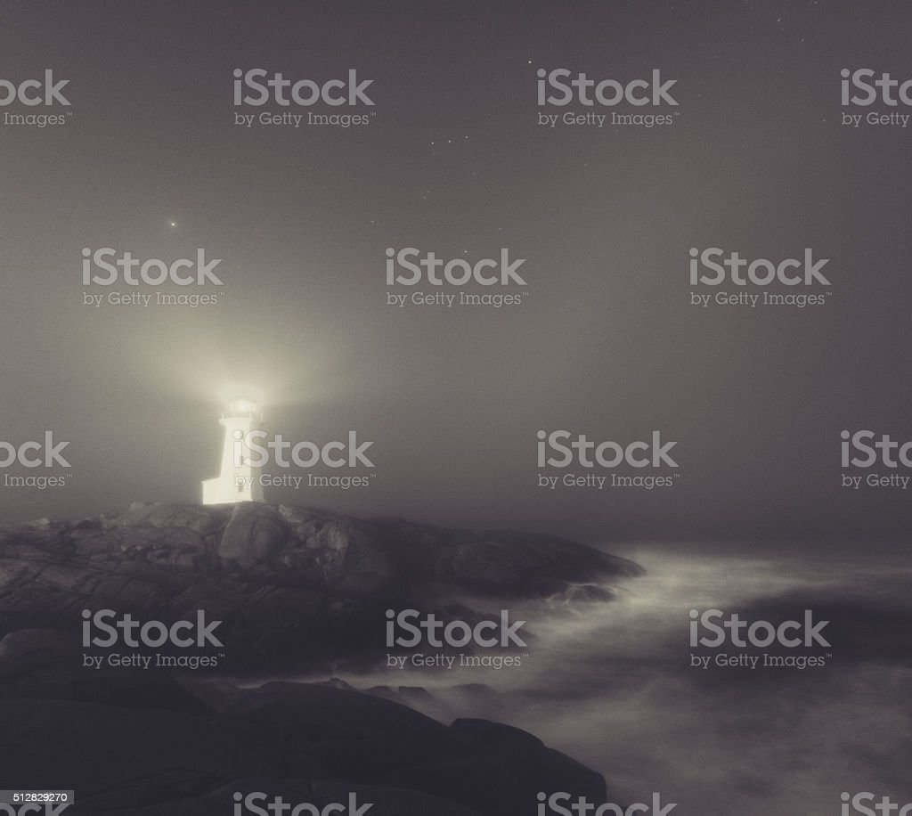 Lighthouse in Fog stock photo