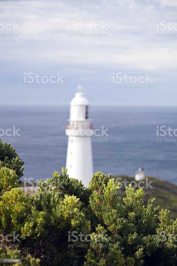 Lighthouse in front of the sea stock photo