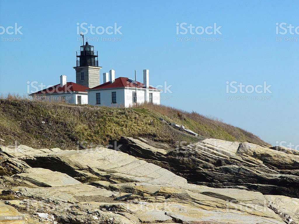 Lighthouse in Jamestown Rhode Island by the Rocks stock photo