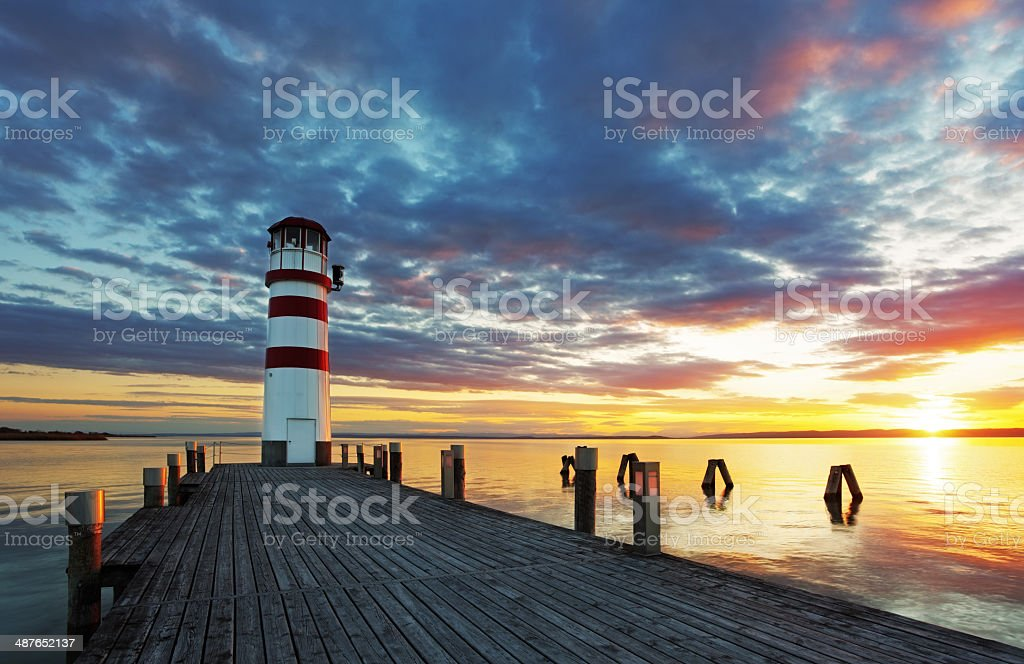 Lighthouse in Lake Neusiedl at sunset stock photo
